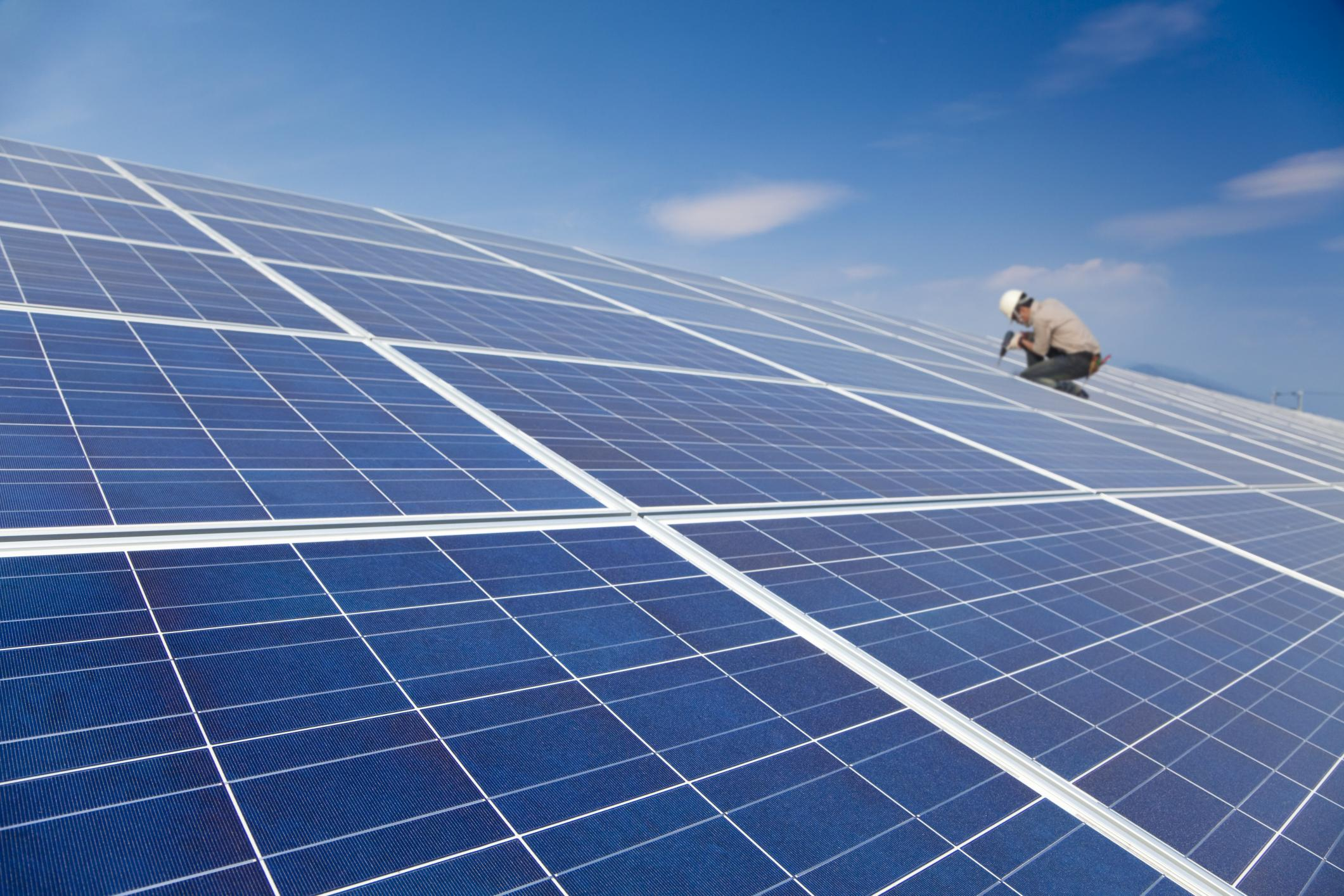 Worker on a solar panel