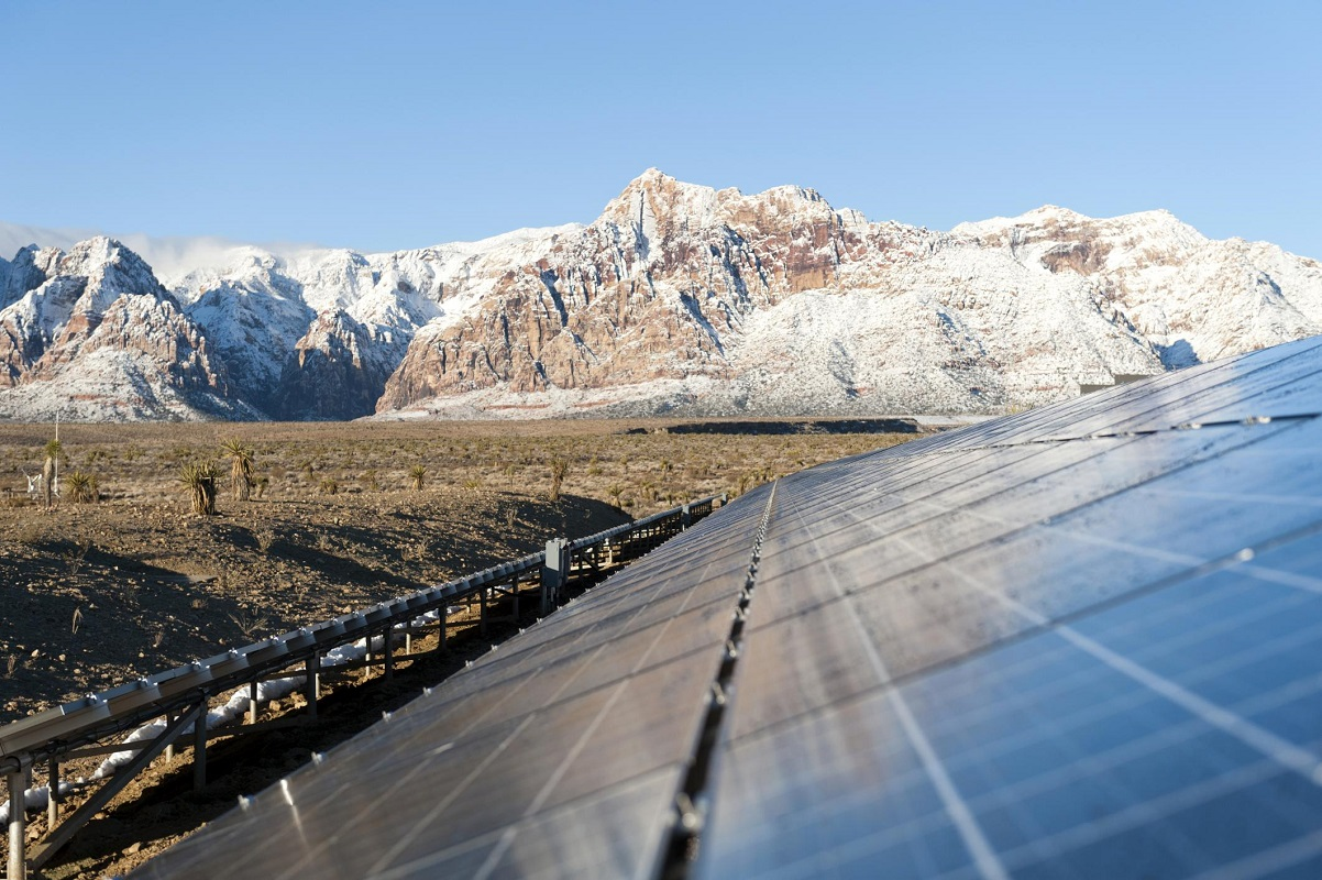 solar panels and snowy mountains