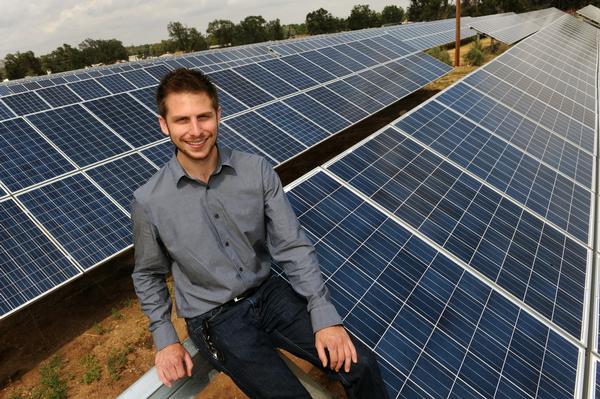 Man sitting on a solar panels