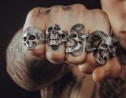 https://www.pexels.com/photo/man-wearing-silver-skull-ring-194087/