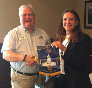 Jim Ogle presents Topeka Rotary flag to Lawrence Central Rotary.