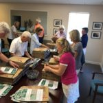 Residents assembling bags for Food Drive at Foundation office.