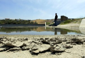 n this July 2, 2015 photo, Rich Kissee, Operations Manager for the Santa Margarita Water District stands on the edge of a water runoff reservoir, in Rancho Santa Margarita, Calif. Despite the drought continuing into a fifth year, California water suppliers no longer have a state-imposed water conservation mandate. (Chris Carlson, AP)