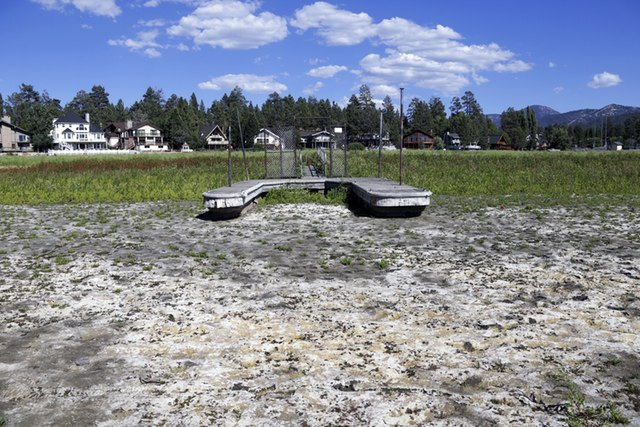 This Aug. 24, 2015, file photo, shows a boat dock by the lake bed where water has dried due to the drought at Big Bear Lake, Calif.Nick Ut, AP