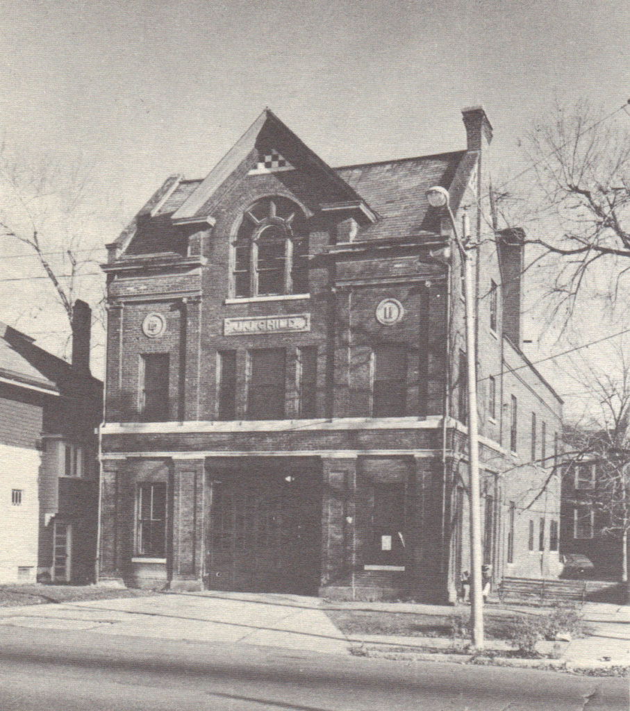 Black and white photograph of facade and south side of former JJ Child Steamer Company building