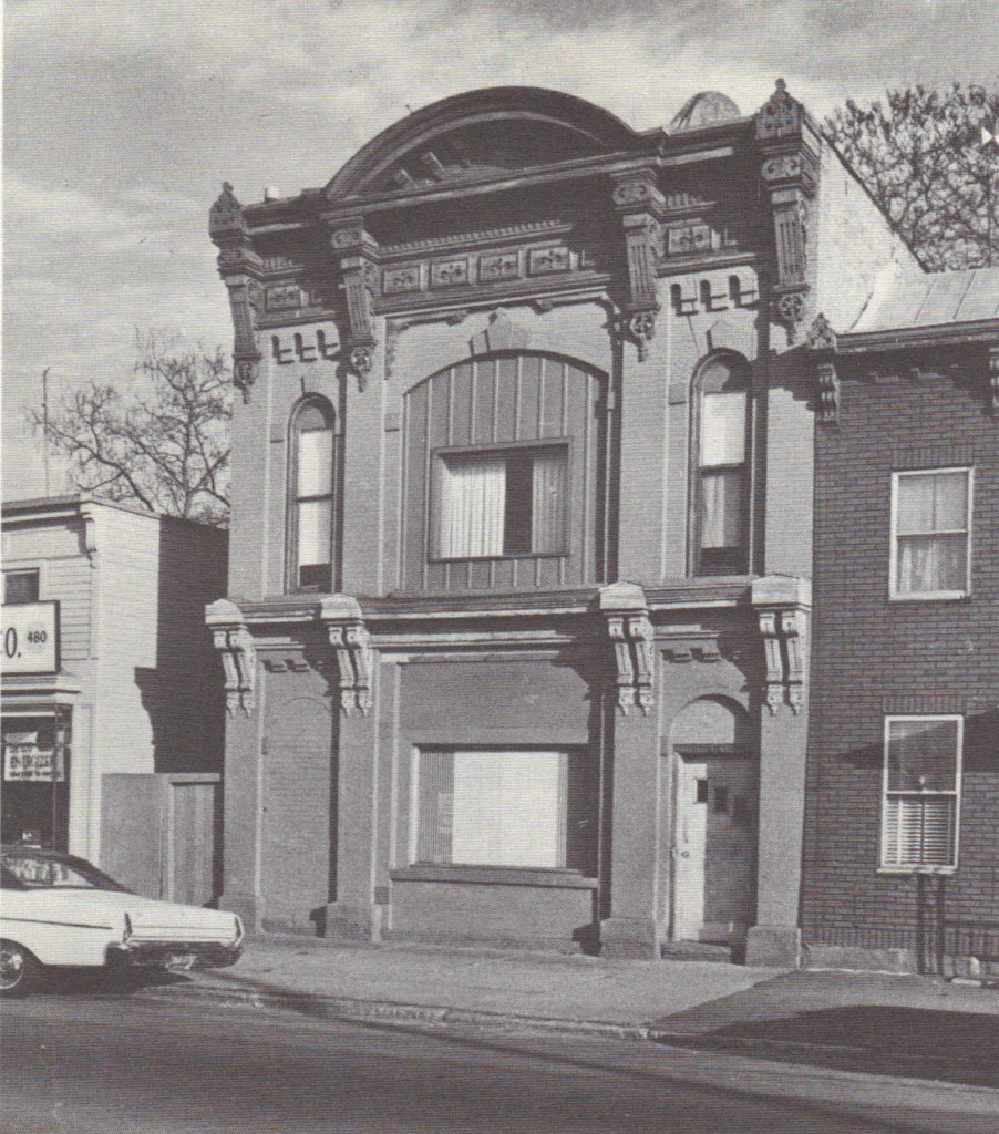 Black and white photograph of facade of former J. Fox Steam Fire Engine Company.