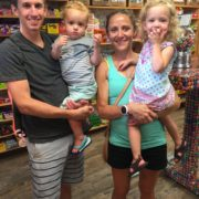 Runner family posing for picture inside store