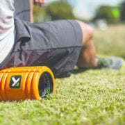 Man using a trigger point foam roller