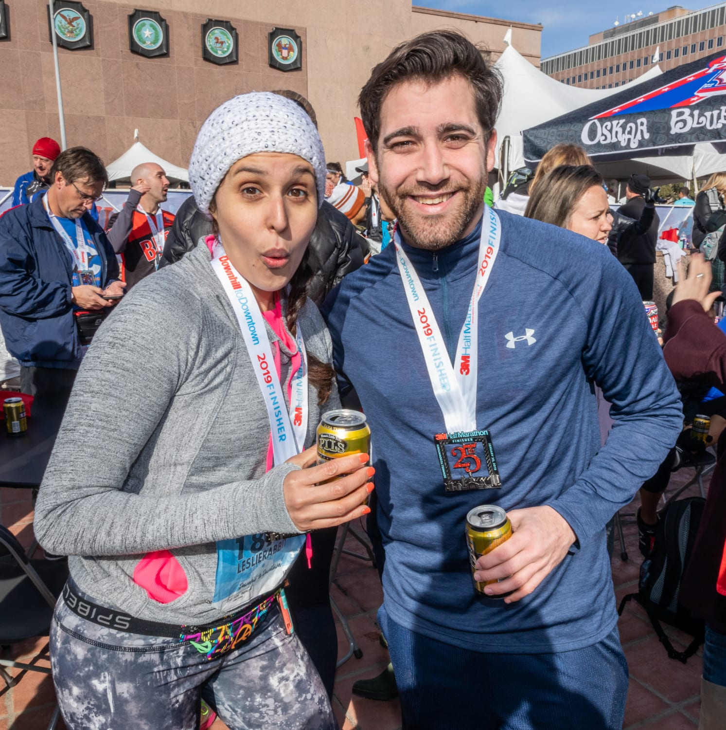 Participants celebrate their accomplishment in the beer garden, one reason people love 3M Half Marathon.