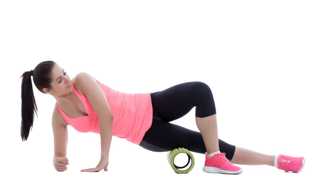 Runner is taking advantage of foam rolling and its benefits.