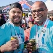 Participants enjoy a cold Oskar Blues beer, the Official Beer Sponsor of the 3M Half Marathon.