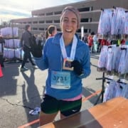 Lauren Dehdari, 2020 3M Half Ambassador, poses at the 2019 3M Half Marathon finish line.