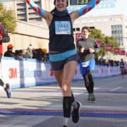 Liubov Lomonosova, 2020 3M Half Ambassador, crosses the 2019 3M Half Marathon finish line with excitement.
