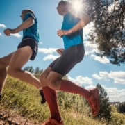 Two trail runners run together to stay safe.