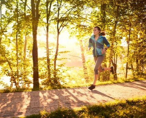 Runner enjoys her morning run along a trail.