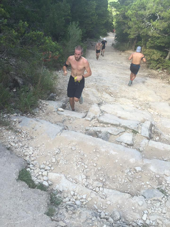 Runner ascends Hill of Life, one of the High Five Events' staff's favorite Austin hill workout locations.
