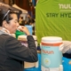 Participant drinks Nuun, the Official Hydration of the 3M Half Marathon.
