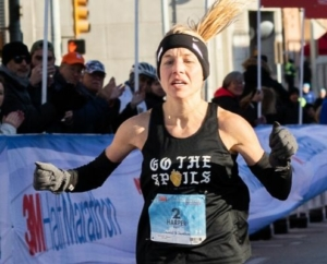 Image of Jess Harper as she crosses the 2019 3M Half Marathon finish line as the female champ. She is the 2018 and 2019 female champ and will run with the 2020 elite field.