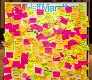 Image of the Post-it Wall from the 2019 3M Half Marathon expo covered in messages of support and inspiration. The Post-it Wall will be a 2020 expo highlight.