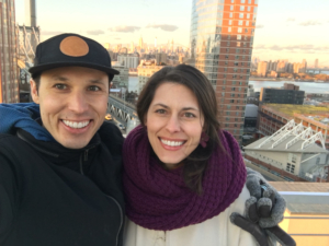 Image of Ben Munguia and his wife Lauren overlooking a skyline. Munguia will run with the 2020 elite field at the 2020 3M Half Marathon presented by Under Armour.