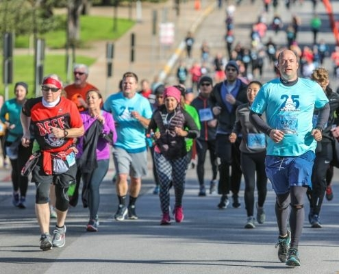 Image of group of runners during the 2019 3M Half Marathon presented by Under Armour. 2020 3M Half Marathon announces the return of Ascension Seton as the Official Medical Provider.