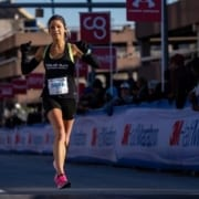 A female runner cruises to the 2020 3M Half Marathon finish line. The tips and advice in this blog will help you grow as a runner and prepare for your next finish line.