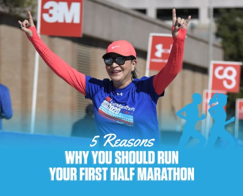 Image of female runner with her hands raised while crossing the 2020 3M Half Marathon finish line. Run your first half marathon at 3M Half Marathon and this commemorative spinner finisher medal is just one of the perks you'll receive!