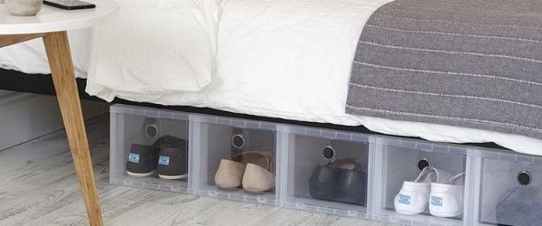 Various plastic containers store pairs of shoes under a bed as an example of different ways to organize your running shoes. Click on the image's link to visit 3M Half Marathon's Pinterest page for more ideas.