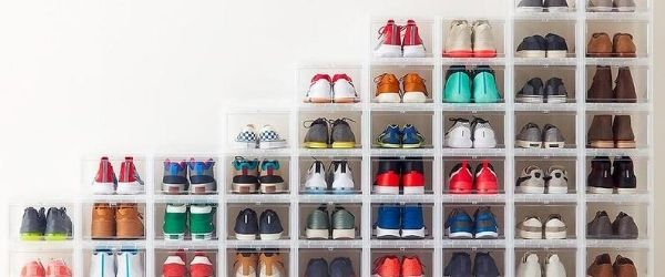 Stacks of space-saving plastic containers are filled with shoes. It's an example of different ways to organize your running shoes. Click on the image's link to visit 3M Half Marathon's Pinterest page for more ideas.