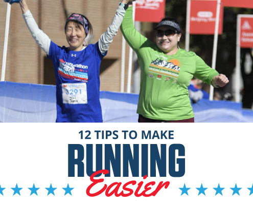 Two female runners cross the 2020 3M Half Marathon finish line with their hands raised in the air. Text in design reads 12 Tips to Make Running Easier. Learn more at https://downhilltodowntown.com/make-running-easier/