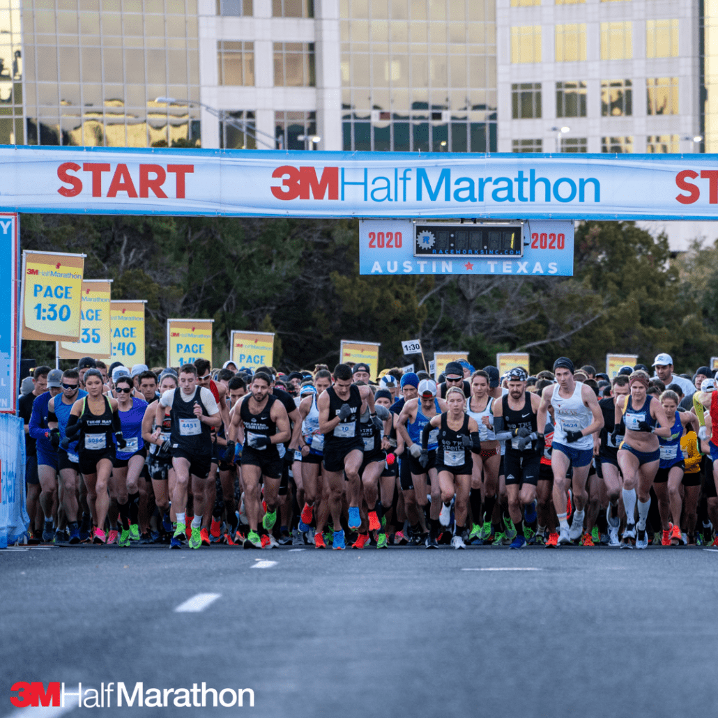 3m half marathon start line with pace signs and half marathon pacers