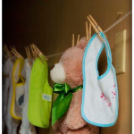 baby shower clothes line, teddy bear and DIY bibs and onesies
