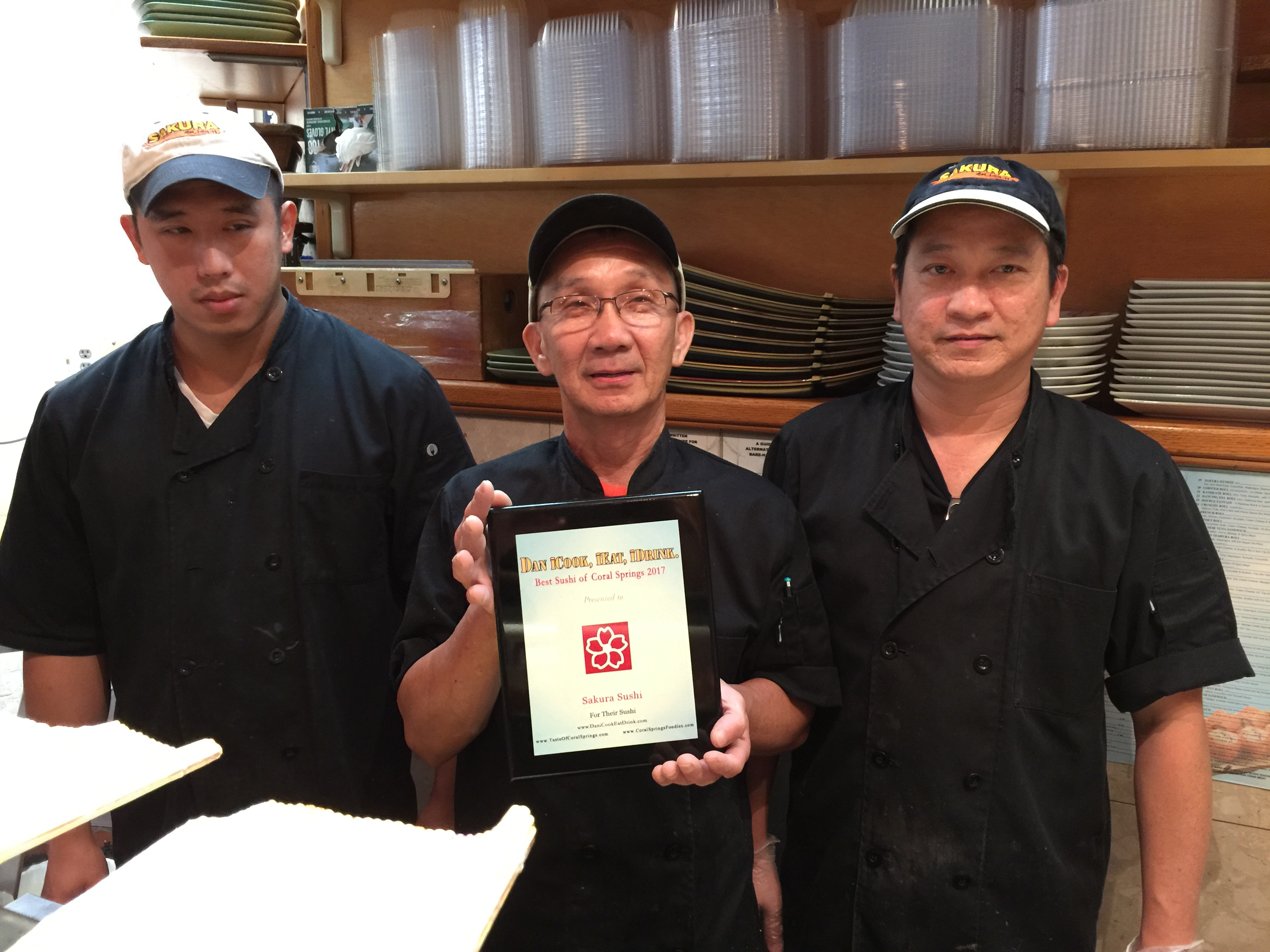 Holding plaque is Owner Ming