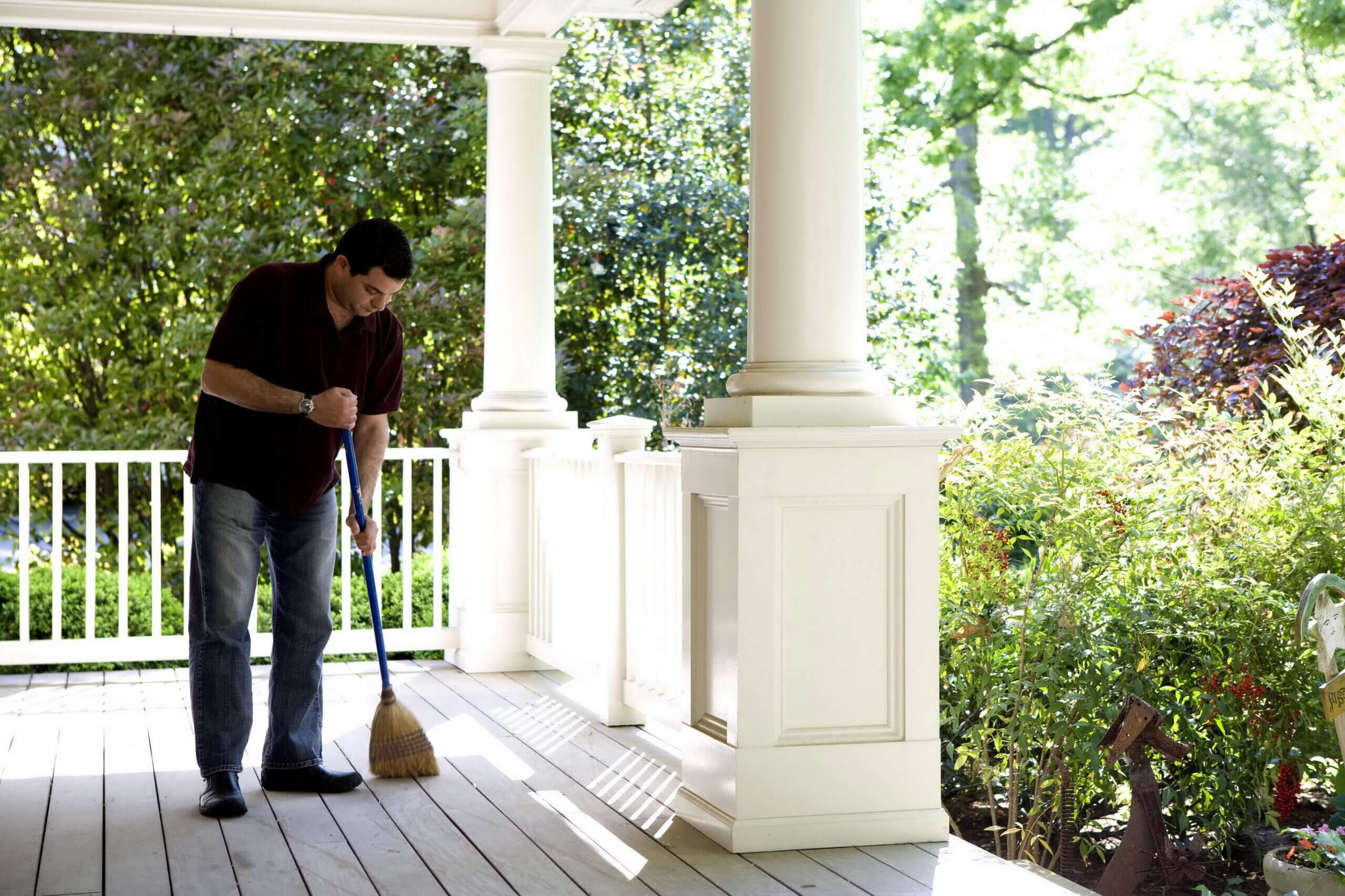 Man Cleaning Porch