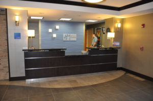 Custom commercial millwork for a front desk of a hotel in Grand Junction