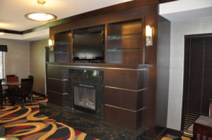 Custom commercial millwork for a fireplace at a hotel in Grand Junction