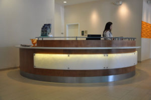 Custom commercial millwork for a front desk at a hotel in Grand Junction
