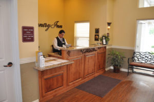Custom commercial millwork for the front desk of Wine Country Inn in Palisade