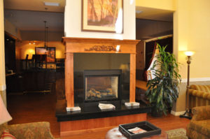 Custom commercial millwork for the fireplace of Wine Country Inn in Palisade