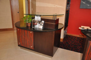 Custom commercial millwork of a reception pod at the Doubletree Inn, Grand Junction