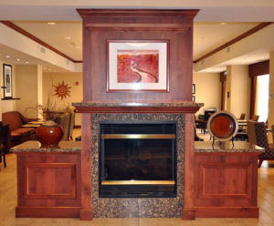 Photo of commercial millwork for fireplace in a hotel in Moab, U