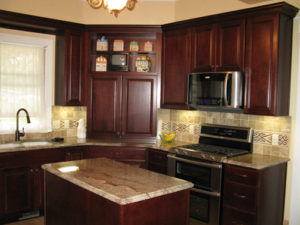 Photo of a cherry wood kitchen cabinets on a Victorian remodel in Grand Junction