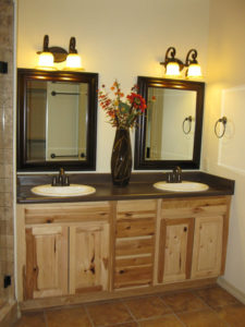 Natural hickory bathroom cabinets in a Grand Junction home