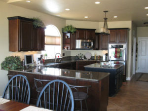 Cherry wood kitchen cabinets in a Grand Junction home