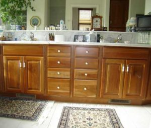 Photo of cherry wood bathroom cabinets