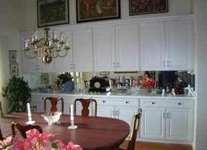Photo of painted white thermofoil dining room buffet and cabinets