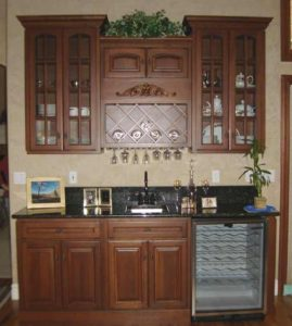 Photo of cherry wood wetbar and cabinets in Grand Junction home
