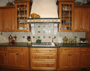 hoto of custom cherry wood cabinets and drawers in Grand Junction home