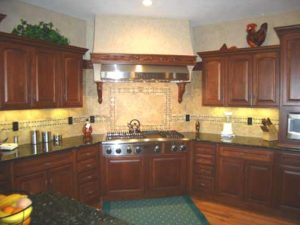 Photo of dark maple kitchen cabinets and drawers in Grand Junction home
