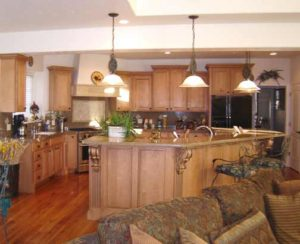Photo of maple wood kitchen cabinets and island in Grand Junction home